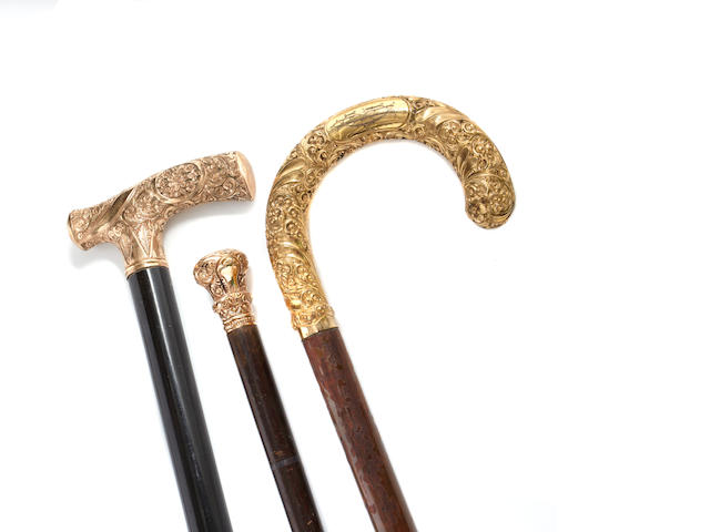 A group of three  yellow gold-handled  dress canes Late 19th/20th century