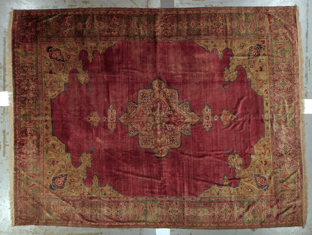 A Hadji Jalili Tabriz silk carpet size approximately 10 ft. 6in. x 13ft. 10in.