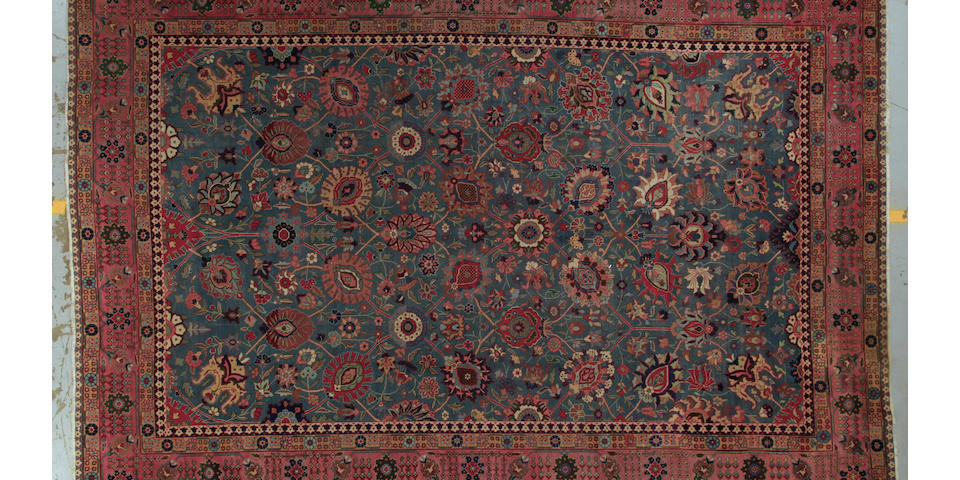 A Tabriz carpet size approximately 8ft. 11in. x 13ft. 2in.