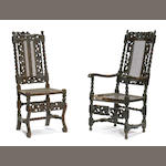 A group of seven assembled Baroque carved walnut and caned chairs