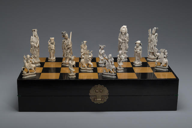 A tinted ivory chess set 20th century