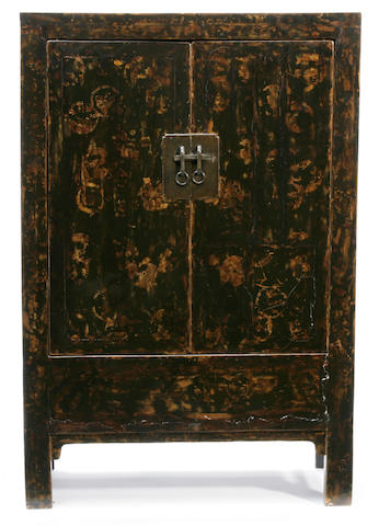 A Chinese black lacquered cabinet