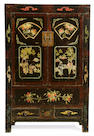 A  Chinese double door cupboard painted with birds, flowers, peaches and pomegranets