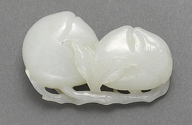 A white jade peach group Qing dynasty