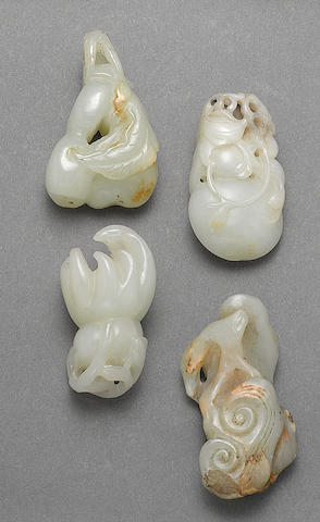 A group of four greenish-white jade toggles  Late Qing/Republic period