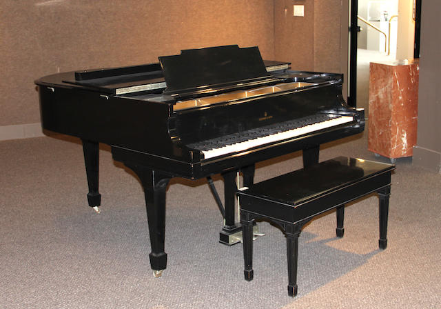 A Steinway & Sons model M ebonized piano