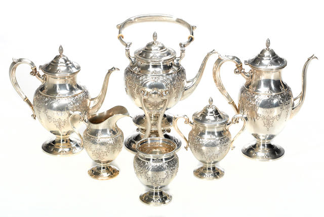A hand chased sterling six piece tea and coffee set Fisher Silversmiths, Inc., Jersey City, NJ M. Fred Hirsch Co., Inc., Jersey City, NY  St James, #s 2311 (kettle), 411 (others), monogrammed: GEB