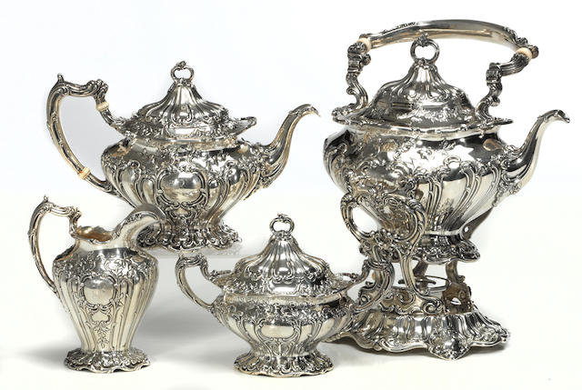 A sterling four piece Chantilly tea set Gorham Mfg. Co., Providence, RI, dated 1902  #s A597, A598, A599 and A601, with hand chased decoration, monogrammed: B, engraved on undersides: C G Berryman, 1902