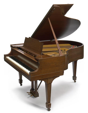 A Steinway model M mahogany grand piano