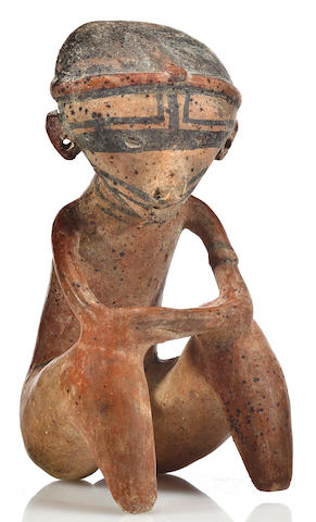 A Chinesco seated figure