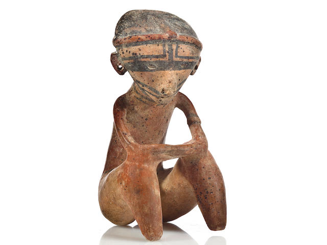 A Chinesco seated figure