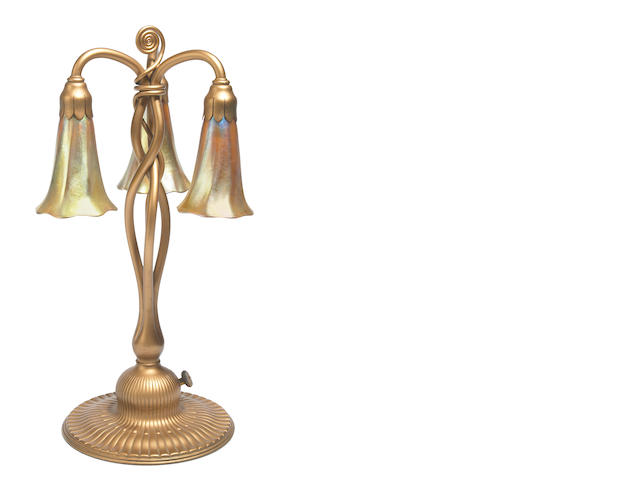 Tiffany Favrile glass and gilt bronze three light lily lamp