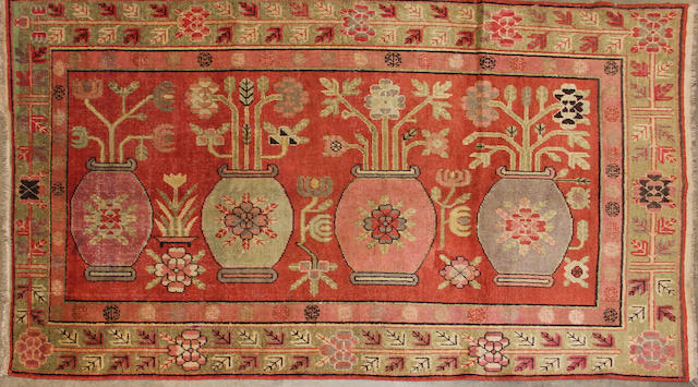 A Samarkand rug size approximately 5ft. 1in. x 8ft. 9in.