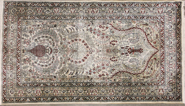 A Chinese silk rug size approximately 4ft. 3in. x 9ft. 7in.