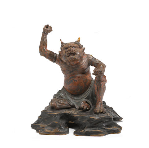 A small lacquered wood sculpture of an oni  17th/18th century
