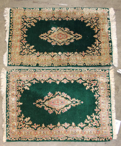 A pair of Kerman rugs   size approximately 2ft. 6in. x 3ft. 2in. each.