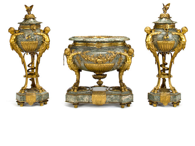 An important and fine Louis XVI style gilt bronze mounted vert maurin marble three piece garniture<br>attributed to Henry Dasson (French, XXXX-XXXX)<br>third quarter 19th century