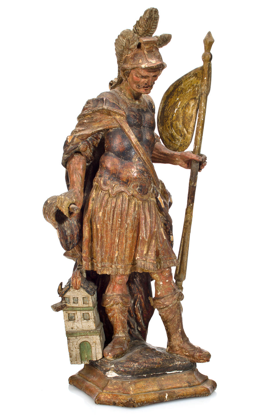 A Continental carved and polychromed limewood figure of St. Florian Tyrolean, 18th century