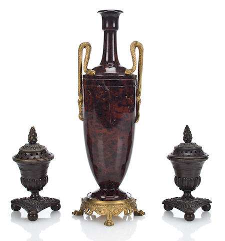 A French Neoclassical style gilt bronze mounted red-black marble vase with snake handles circa 1900