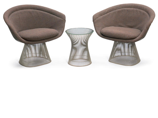 A pair of Warren Platner wire lounge chairs and a similar side table