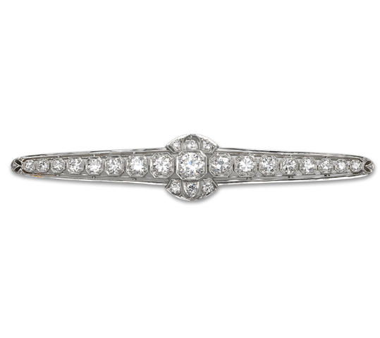 A diamond and platinum bar brooch