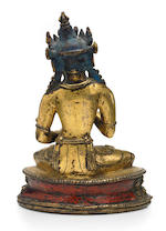 A gilt copper alloy figure of Vajrasattva Tibet or Nepal, 13th/14th century