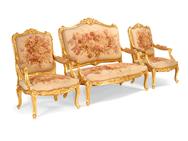 A fine Louis XV style giltwood and tapestry upholstered suite of seating furniture fourth quarter 19th century