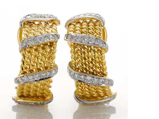 A pair of diamond and eighteen karat bicolor gold half-hoop earclips, Schlumberger, Tiffany & Co.