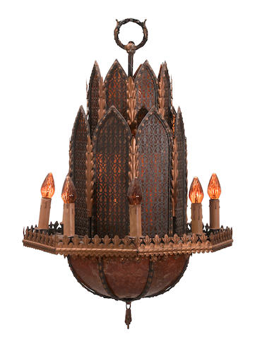 A Moorish style patinated and parcel gilt metal and mica eight light chandelier circa 1928