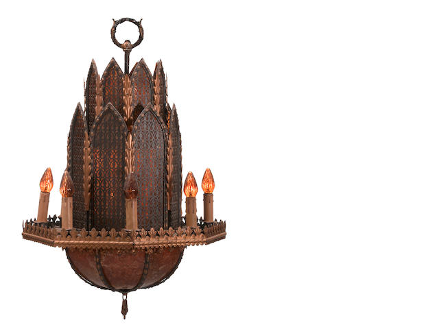 A Gothic style patinated metal and mica eight light chandelier