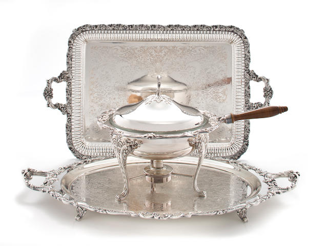A Victorian silverplated two handled tray and a  silver plated chafing dish on lampstand and A silver plated oval two handled tray<br>late 19th century and later