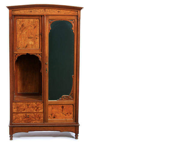 An Art Nouveau marquetry, figured wood and fruitwood mirrored armoire