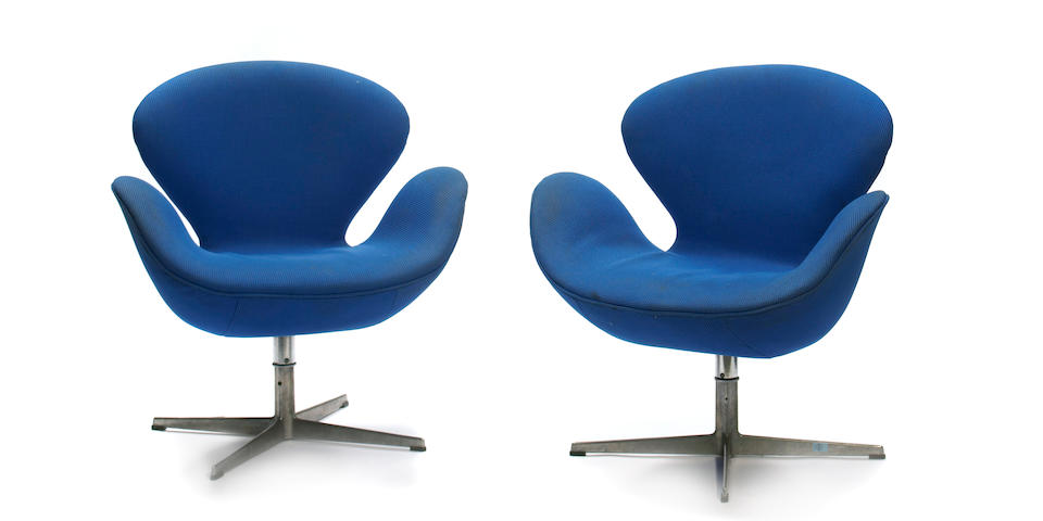 A set of four Arne Jacobsen aluminum and upholstered 'Swan' chairs