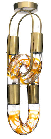 A contemporary glass and brass link form chandelier, attributed to Maison Jansen