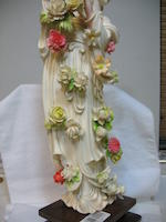 A polychrome tinted ivory flower maiden 20th century