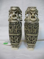 A pair of pieced and tinted ivory covered vases Republic period