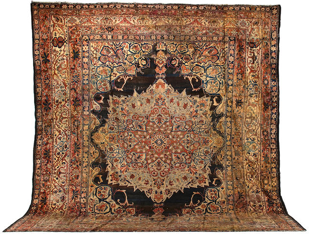 A Fereghan Sarouk carpet size approximately 13ft. 8in. x 16ft.