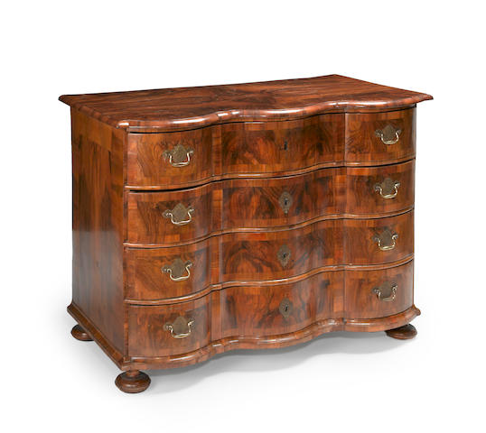 A German Rococo walnut chest of drawers<br>mid 18th century