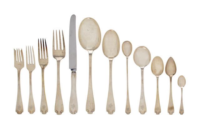 An American sterling silver flatware service Manufactured and retailed by Tiffany & Co., New York, circa 1911 Flemish pattern, comprising: twelve dinner forks- 7 3/4in, eleven luncheon forks- 7in, eleven salad forks- 6 3/4in, twelve dinner knives, eleven teaspoons- 6in, twelve cream soupspoons-6 7/8in, ten citrus spoons- 5 7/8in, ten demitasse spoons-4 in, twelve iced teaspoons- 7 1/2in, a serving fork, three various serving spoons, each engraved with a script monogram ABG, approximately 149 oz troy weighable silver