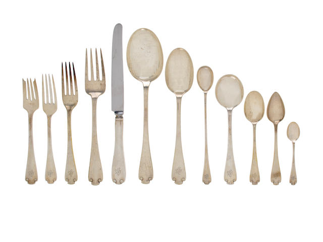 An American sterling silver flatware service<br>Manufactured and retailed by Tiffany & Co., New York, circa 1911 Flemish pattern, comprising: twelve dinner forks- 7 3/4in, eleven luncheon forks- 7in, eleven salad forks- 6 3/4in, twelve dinner knives, eleven teaspoons- 6in, twelve cream soupspoons-6 7/8in, ten citrus spoons- 5 7/8in, ten demitasse spoons-4 in, twelve iced teaspoons- 7 1/2in, a serving fork, three various serving spoons, each engraved with a script monogram ABG, approximately 149 oz troy weighable silver