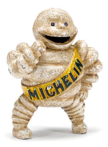 A rare Michelin 'Bibendum' cast iron bank,