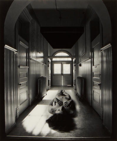 Jerry Uelsmann (American, born 1934); Untitled (Reclining nude in hallway);