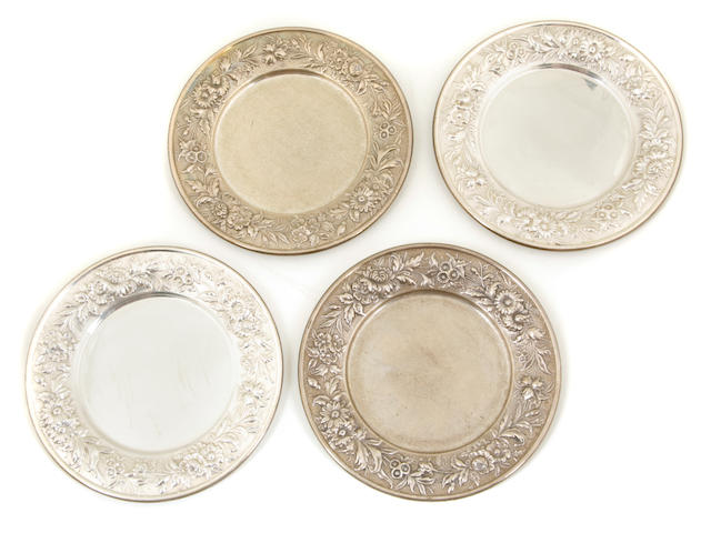 A set of twenty-six S. Kirk & Son Inc.  sterling silver  'Repousse' bread plates circa 1930