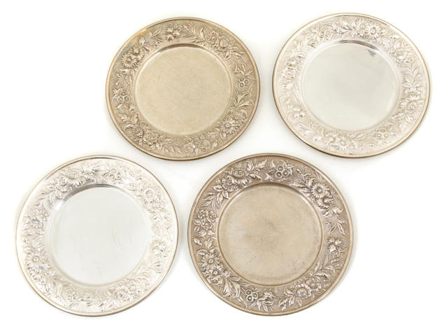 A set of twenty-six S. Kirk & Son Inc.  sterling silver  'Repousse' bread plates circa 1930