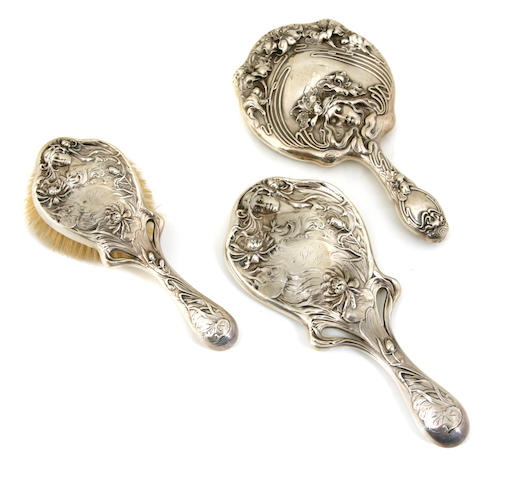 A group of three American Art Nouveau sterling silver  vanity items Mauser Mfg. Co., New York, Early 20th century