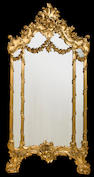 A Venetian Rococo style carved and giltwood overmantel mirror<br>late 19th/early 20th century