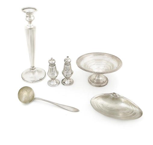 An assembled group of silver and sterling silver hollowware and utensils 19th - 20th century