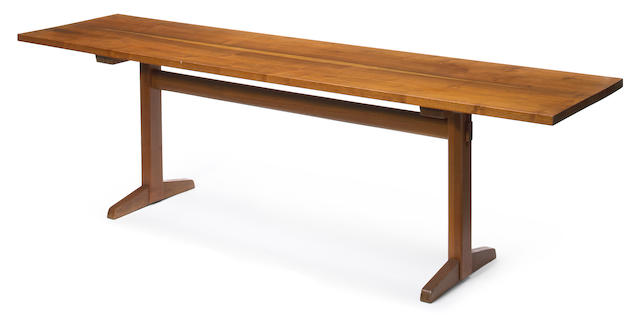 A George Nakashima laurel and walnut trestle dining table 1958