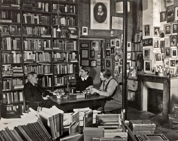 Gisèle Freund (French, 1912-2000); James Joyce with Adrienne Monnier and Sylvia Beach in Shakespeare and Co.  Book Shop;