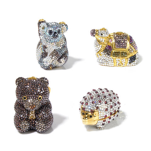 A collection of 4 animal pillboxes- camel, koala, porcupine and teddy bear
